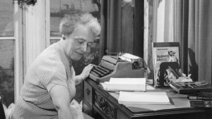 Helen Creighton at desk
